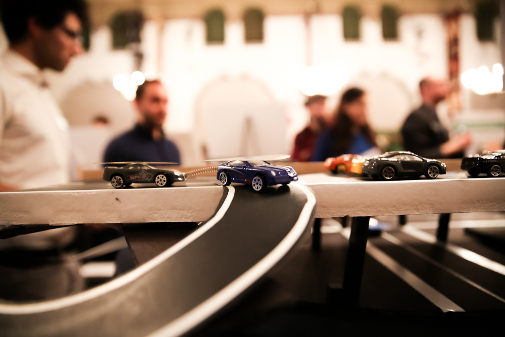 toy cars driving on a track