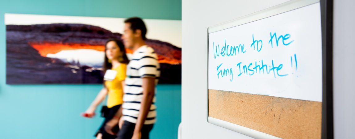 "a whiteboard reading ""Welcome to the Fung Institute!"""