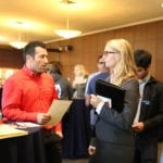 A MEng student talking to an employer at Employer Breakfast